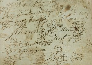 Detail of a sheet of scrap paper with calculations and Hardenbergh's name in the ledger