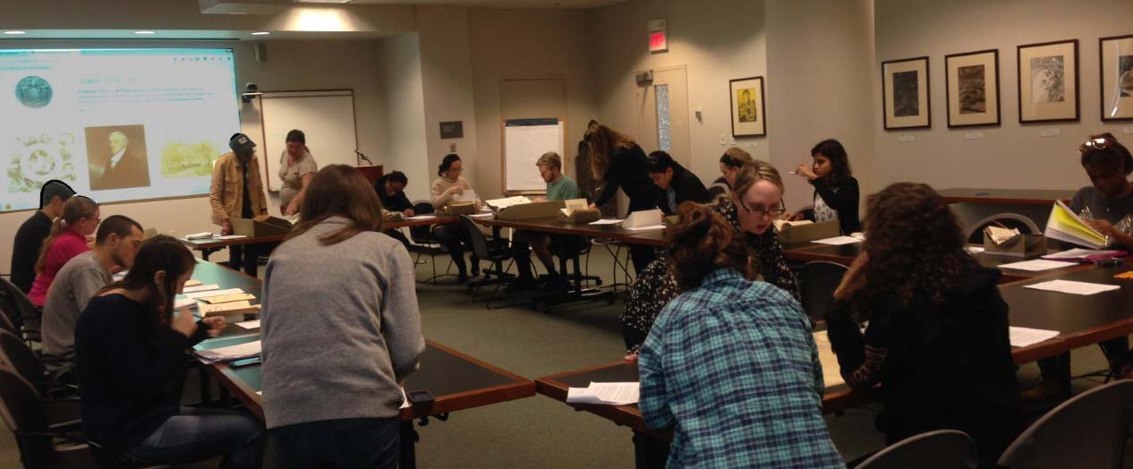 Rutgers students studying rare herbals, cook books and and materials from the Sinclair NJ cookbook collection