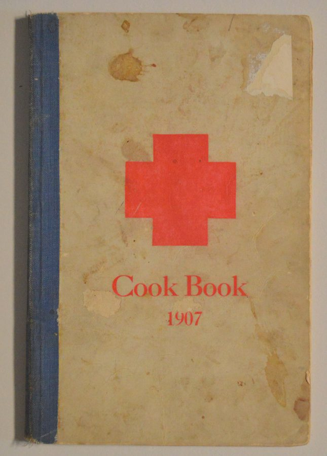 Cover of a 1907 cookbook with a red cross on the front.